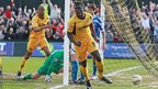 Portsmouth take a two-goal lead and despite Ismail Yakubu giving Newport hope with a late goal the Welsh side lose 2-1