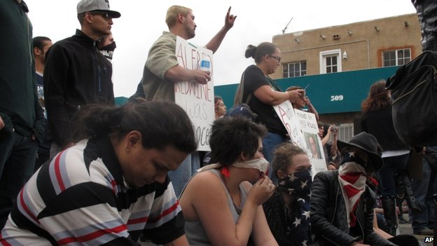 Protesters hold a sit-in in downtown Albuquerque during a rally against recent police shootings on 30 March 2014