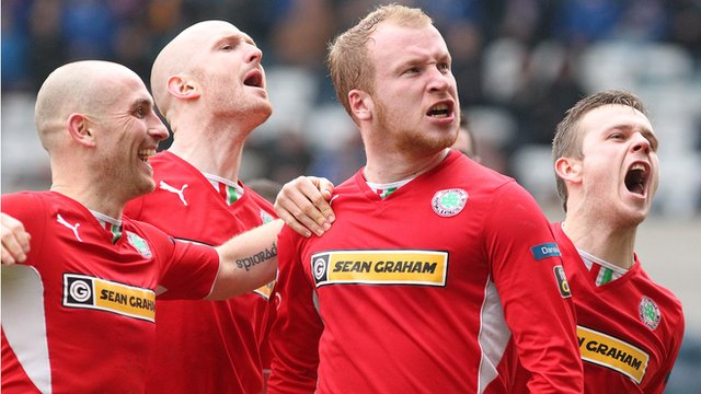 Cliftonville players celebrate victory over Linfield at Windsor Park