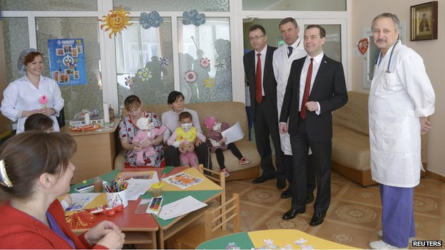 Russia's Prime Minister Dmitry Medvedev (2nd R, front) visits a children's hospital in the Crimean city of Simferopol, March 31, 2014