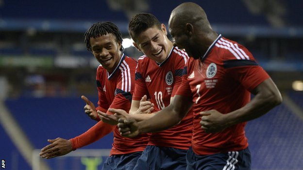 Colombia's Juan Cuadrado (left), James Rodriguez (centre) and Pablo Armero celebrate