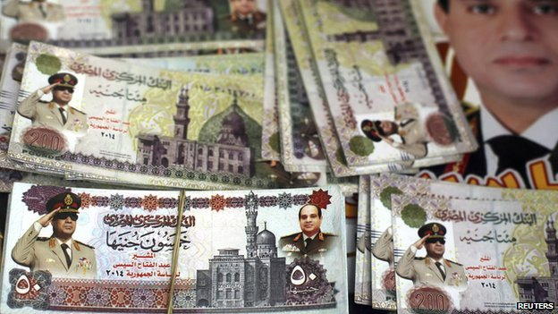 Souvenir fake 200 Egyptian pound notes printed with pictures of Egyt's ex-Field Marshal Abdel Fattah al-Sisi at a bazaar in Tahrir Square in central Cairo, on 13 March 2014