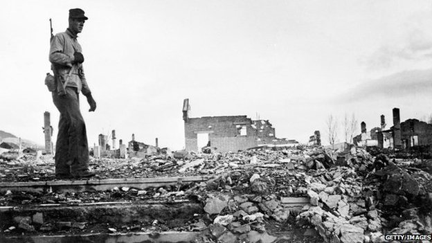US soldier stands among rubble in Korean city of Hamhung