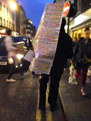 Man with placard Old Compton Street