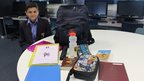School Reporter with bag and contents