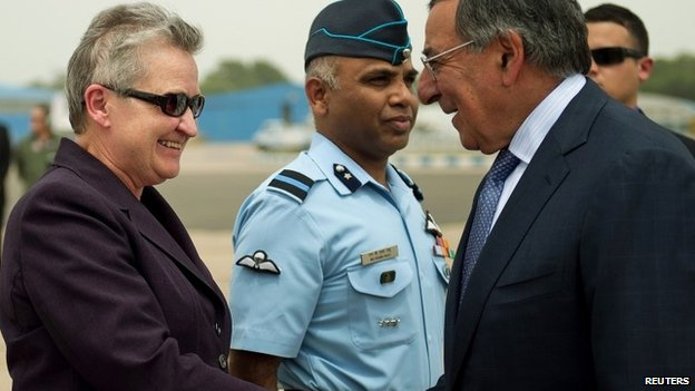 US Defence Secretary Leon Panetta (R) shakes hands with US ambassador to India Nancy Powell upon his arrival in New Delhi in this 5 June 2012