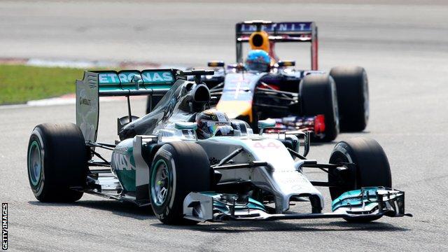 Mercedes' Lewis Hamilton leads Red Bull's Sebastian Vettel