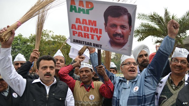 Aam Aadmi Party activists hold brooms as they shout-slogans during protest against the corrupt political system in Amritsar on February 15, 2014