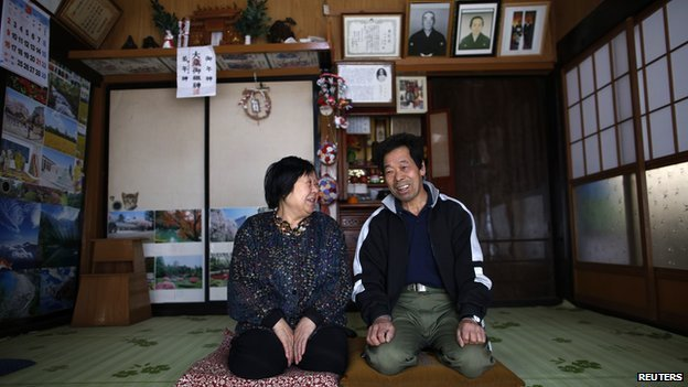 Toshio Koyama, 72, and his wife Kimiko, 69, who evacuated from the Miyakoji area of Tamura three years ago, smile after they returned to their home in Tamura, Fukushima prefecture on 1 April, 2014