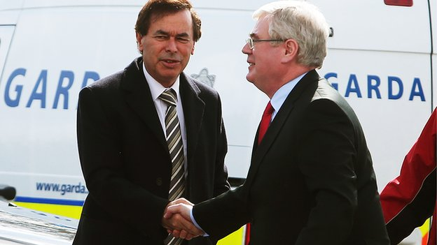 Justice Minster Alan Shatter (left) greets Labour leader and Irish Deputy Prime Minister Eamon Gilmore