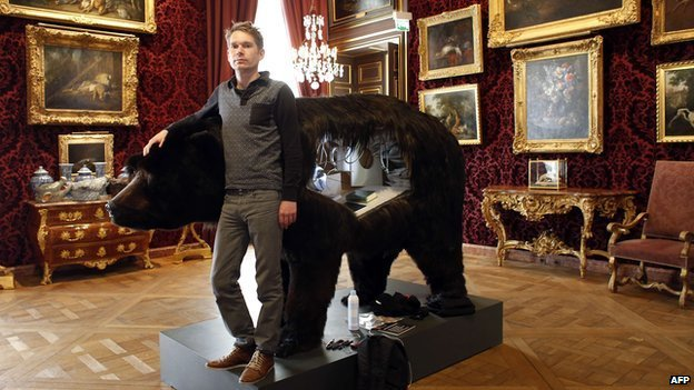 Abraham Poincheval beside his bear at the Hunting and Wildlife Museum in Paris