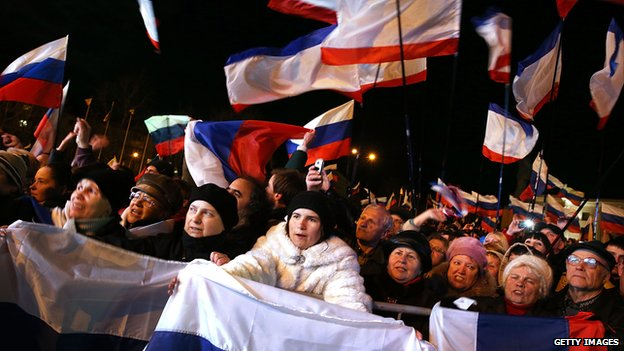 People in Simferopol, Ukraine attend a pro-Russian rally on March 16, 2014