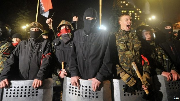 Right Sector members protest in front of the Ukrainian parliament in Kiev - 27 March 2014