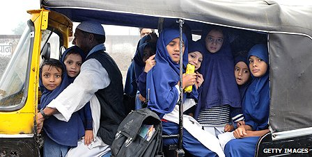 Children in the Indian city of Bhopal are ferried to school