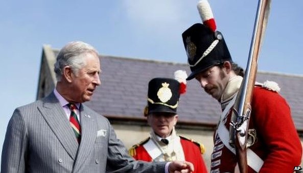 The prince met men dressed in period military costume