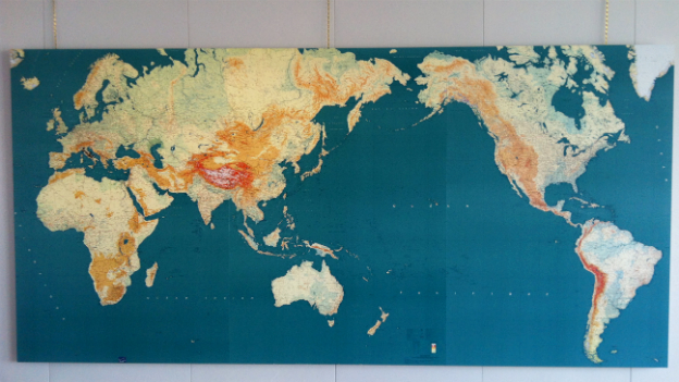 The Chinese map of the world that hangs on the wall in Mr Barnier's office