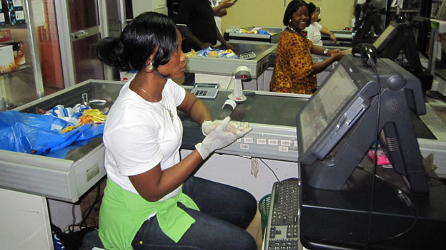 Supermarket checkout staff wearing gloves in Liberia