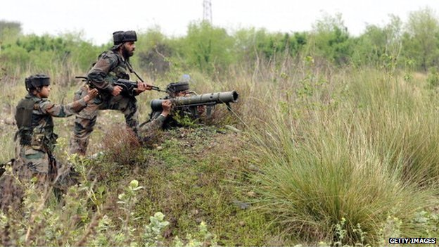 Indian army jawans taking position during an encounter with terrorists at Janglote village on 28 March, 2014 in Kathua, about 80 km from Jammu, India