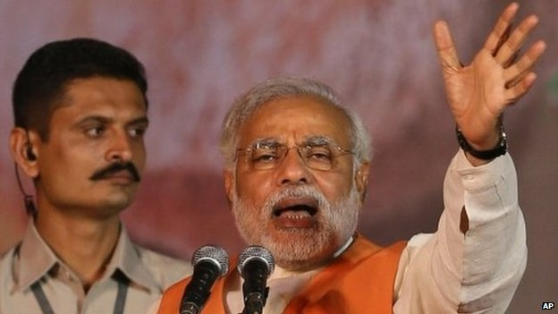 Narendra Modi addresses an election rally in New Delhi, India, Wednesday, March 26, 2014