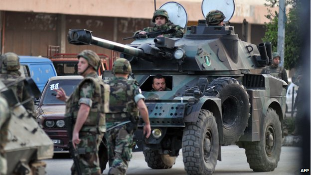 A Lebanese army vehicle carrying Lebanese soldiers is deployed on the street of the northern Lebanese city of Tripoli on April 2