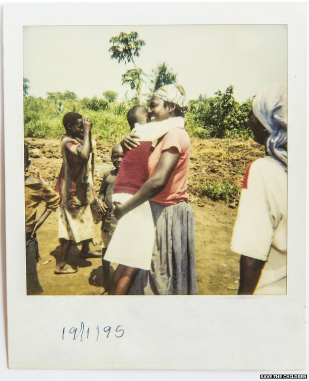 A Polaroid photo of the moment of reunification between separated children and their family.