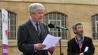 Tony Hall reading W H Auden's Funeral Blues in piazza of BH
