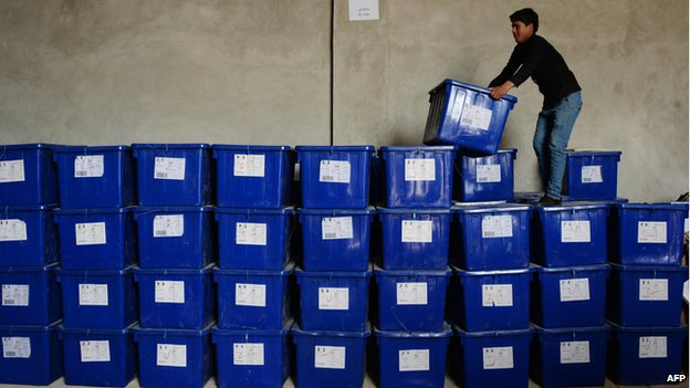 Afghan election worker stacks ballot boxes in Mazar-e Sharif, northern Afghanistan (1 April)