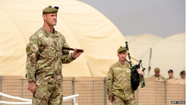 British army soldiers look on during a ceremony to disband the British military headquarters at Camp Bastion Helmand province on 1 April