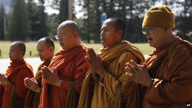 Buddhist monks, from the Atammayatarama Buddhist Monastery in Woodinville, chant for the victims of a deadly mudslide near a west side road block in Oso, Washington 1 April 2014