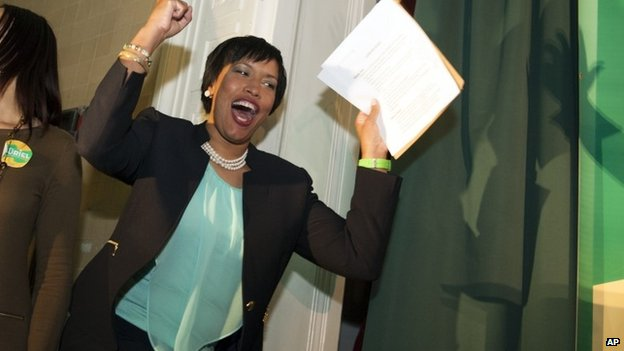 Mayoral candidate, and Council Member Muriel Bowser celebrates as she walks onstage to address supporters in Washington DC 1 April 2014
