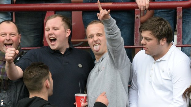Celtic striker Leigh Griffiths (centre) joins Hibs fans at Sunday's Edinburgh derby