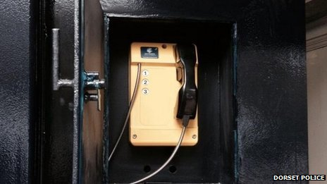 The yellow phone on the outside of the police box