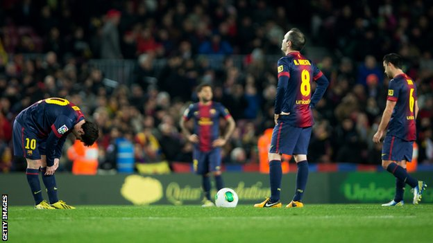Lionel Messi (L) of Barcelona stands with Andres Iniesta, ready to resume the game, after conceding their third goal during the Copa del Rey semi final second leg match.