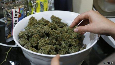 Marijuana buds are prepared for sale in Northglenn, Colorado, on 31 December 2013