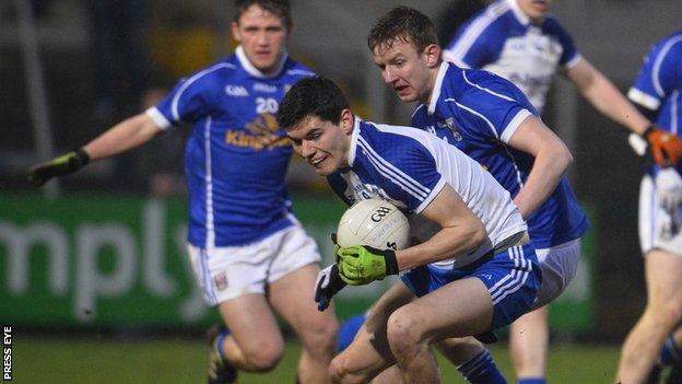 Monaghan's Brian Greenan in action against Brian Sankey of Cavan