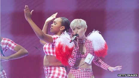 Miley Cyrus performing on stage as part of her Bangerz tour