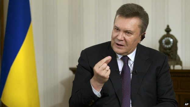 Ousted Ukrainian President Viktor Yanukovych gestures during a TV interview. Photo: 2 April 2014