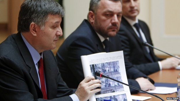 Ukrainian Interior Minister Arsen Avakov shows a photo relating to the shootings. Photo: 3 April 2014