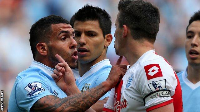 QPR midfielder Joey Barton is confronted by then Manchester City striker Carlos Tevez in 2012