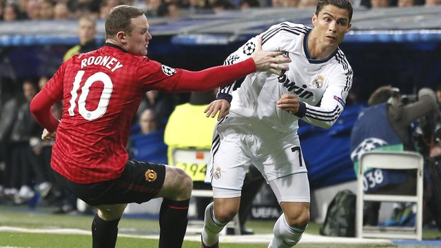 Cristiano Ronaldo (right) pushes the ball past Wayne Rooney during Real Madrid's Champions League victory over Manchester United in 2013