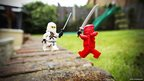 Lego men fight with swords