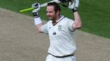 Durham opening batsman Mark Stoneman celebrates reaching his century