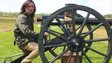 Neil Oliver with a vintage machine gun