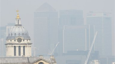 The London skyline seen from Greenwich (buildings in the distance are barely visible through smog)