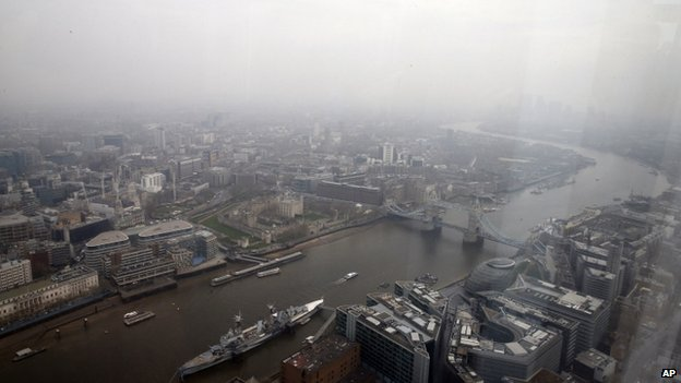 The Thames and Tower Bridge in London under thick smog