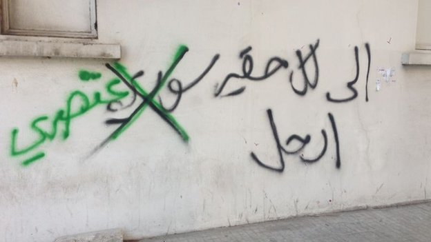 "Graffiti on a wall in Lebanon reading, ""To every despicable Syrian, leave"". Activists crossed out the word ""Syrian"" and instead wrote ""racist""."