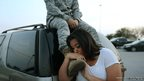 Luci Hamlin and her husband Specialist Timothy Hamlin wait to get back to their home on base at Fort Hood, Texas