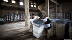Workers prepare ballot boxes at a warehouse in the city of Herat