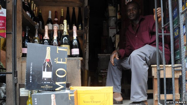 Champagne bottles displayed at a roadside shop in Lagos in April 2013