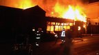 A fire burns at a restaurant after an earthquake in Iquique, Chile, Tuesday, April 1